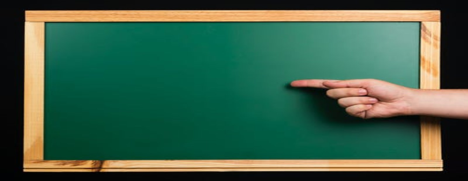 chalkboard with hand pointing at writing